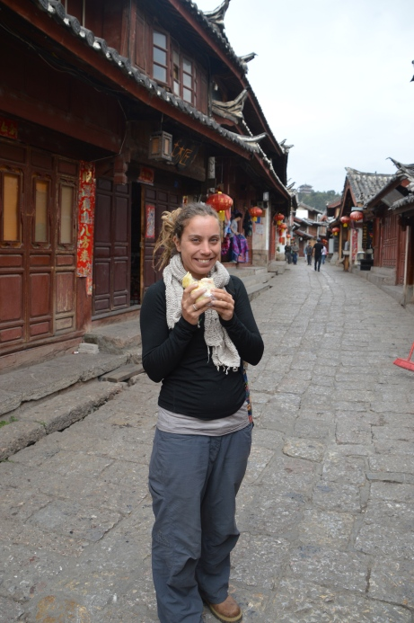 Enjoying street snacks in Lijiang.