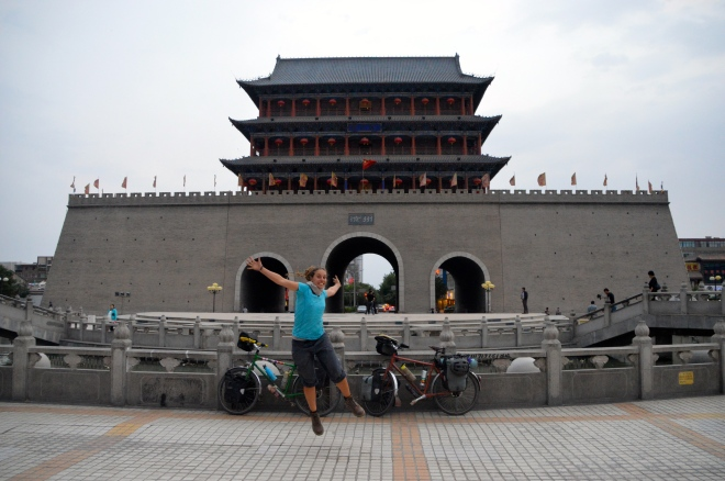 Jumping with joy at the South Gate Wuwei.
