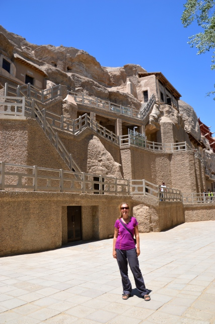 In front of the Mogao Grottoes.