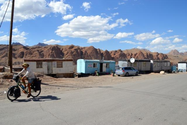 Passing the caravans that surround the Kyrgyz border post.