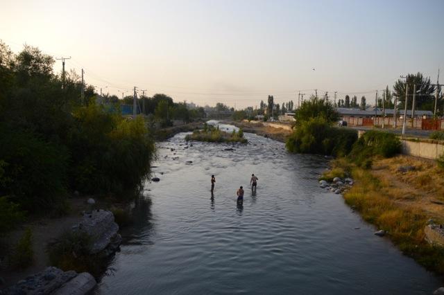 Locals swim in the river.