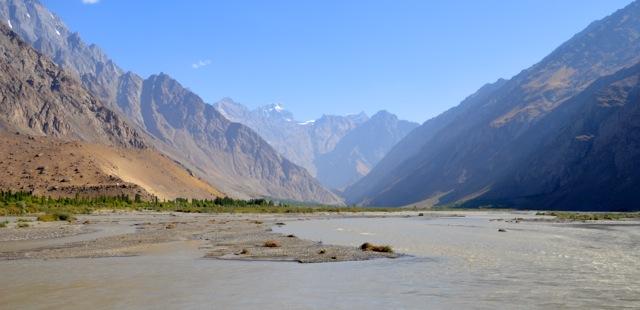 The road hugs the Panj River.