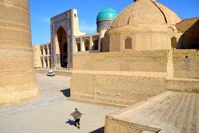 Jude walks through the ruins, Bukhara.