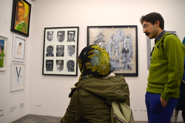 Visiting one of the many art galleries in Tehran, on a Friday night of course.