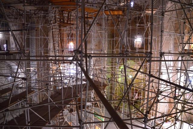 Renovations provide a maze of poles.